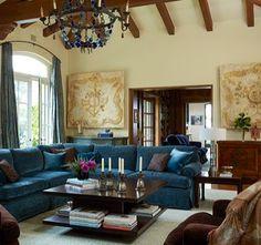Old World. Love the blue velvet sofas.