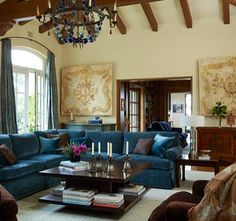 Old World. Love the blue velvet sofas.