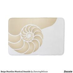 Beige Nautilus Nautical Seaside Bathroom Mat - Subtle shadowing in this beige nautilus nautical seaside bath mat. Perfect for a beach or lake home or anywhere you'd like to bring the love of the sea into your home. Sold at DancingPelican on Zazzle.