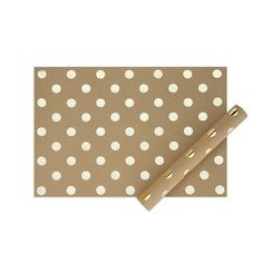 Kraft wrapping sheets with pressed gold foil accents.