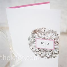 One of the bridesmaids, a graphic designer, used Kelly and Joe's invitations as inspirations to create their programs. The folded programs featured a floral icon with the couple's initials and used the fonts and colors from the invites.