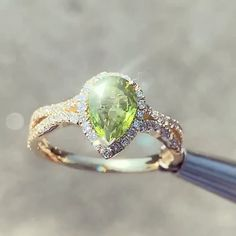 Tennis Bracelet Discover Yellow Gold Peridot and Diamond Ring Pear shapes peridot August birthstone with micro pave diamond halo and wave diamond split shank. Peridot Engagement Rings, Split Shank Engagement Rings, Diamond Wedding Rings, Halo Diamond, Peridot Jewelry, Birthstone Jewelry, Diamond Jewelry, Gemstone Jewelry, Peridot Rings