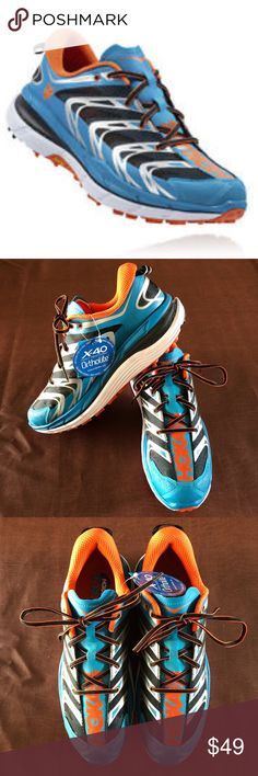 "Hoka One One Men's Speedgoat Running Shoe New with tags, no box! Worn just to try on and walk around the house. Tackle those technical trails with animal-like agility in the Hoka One One Speedgoat trail-running shoe! Inspired by world-class endurance runner Karl Meltzer (a.k.a. ""Speedgoat Karl""), and the harsh conditions of the Speedgoat 50k race. Ultralightweight, no-sew SpeedFrame construction with breathable mesh uppers and supportive welded synthetic overlays. Hoka One One Shoes Athletic…"