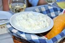 Tzatziki - Cucumber Yogurt Dip     3 tbsp. olive oil      1 tbsp. vinegar      2 cloves garlic, minced finely      1/2 tsp. salt      1/4 tsp. white pepper      1 cup greek yogurt, strained      1 cup sour cream      2 cucumbers, peeled, seeded and diced      1 tsp. chopped fresh dill