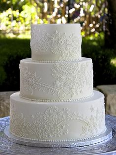wedding cakes lace This white iced cake has cake has been decor. wedding cakes lace This white iced cake has cake has been decorated with a lace pattern to match th Paisley Wedding Cakes, Floral Wedding Cakes, White Wedding Cakes, Elegant Wedding Cakes, Wedding Cake Designs, Henna Wedding Cake, Henna Cake, Wedding Cake With Lace, Wedding Themes