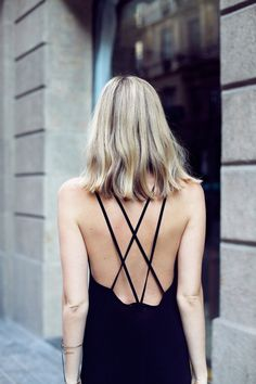 cross straps on the back of the black dress