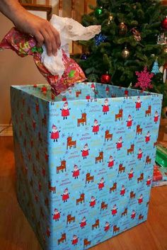 Wrap a large cardboard box in which to place all discarded gift wrap on Christmas morning. It looks far better than trash bags in photos, and the whole thing can be sent to the recycling centre after the holidays. Top Tips for Everything you Need This Christmas | Glamumous!