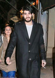 Zayn Malik, looked worlds away from his usual clean-cut appearance as he stepped out for a late-night stroll with pals in New York on Sunday.