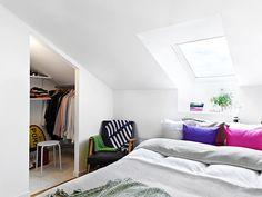 attic bedroom + closet in a nook