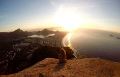 Rio de Janeiro – Stay in a Favela to Hike at Sunrise The #Favela do Vidigal is adjacent to #Ipanema Beach, and offers #spectacular #seaside views. Staying in a guesthouse at the top of the hill allows guests to fully utilize this view!A #key attraction of the Vidigal Favela is its proximity to the #Dois Irmãos (two brothers) hikeIf heading out for sunrise, remember to bring a head torch along with a jacket (it gets windy) #traveltip #travel #tip #sunrise #Brazil