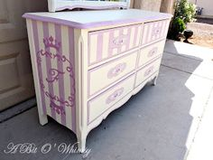 How fun is this dresser?  Love the stripes and color.