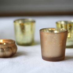 Frosted gold tea light holders available from @theweddingomd The Wedding of my Dreams