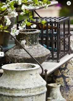 Metal cages with items inside are great for outdoor decor.