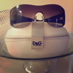 Dolce & Gabbana sunglasses with embellished logo. Rhinestone D&G logo sunglasses with deep plum color sides. Luxurious look. Worn a fair amount of times. Still shiny and in great shape! Comes with everything: lenses cloth, case, and paperwork inserts. Purchased at sunglasses retail store. Dolce & Gabbana Accessories Sunglasses