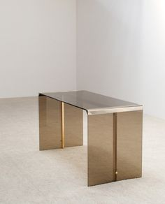 President writing desk and mirrored chest designed by Studio Gallotti Radice in smoked tempered glass Stainless steel and brass ends Matching together with the shelving system and Breuer chair | http://www.furniture-love.com/browse.php | From selection of important 20th century modern furniture