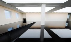 Richard Wilson's 20:50 at the Saatchi Gallery. The dark mirror on the floor is reclaimed sump oil, smelly but stunning.