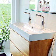 Sink cabinet. It's really hard to find a small one that has two faucets, from Ikea.