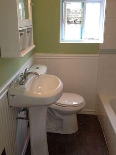 I had to do some serious convincing to get a green bathroom, but I feel the colors come together nicely. Since there was not a lot of floor space in this full bathroom we opted for a slim pedestal sink instead of a vanity, and made up for the storage space with a larger medicine cabinet with built in shelves