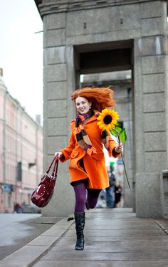 Bold winter look. Why be drab? Take inspiration from the stunning fall colors from sunsets to turning leaves. Orange coat, purple tights