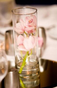 Something a little easier than completely submerging flowers... possibility for the lower centerpieces using beakers.