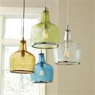 Ballard makes these (Addie Pendant). Love the glass, the colors, and I would love them over the island.