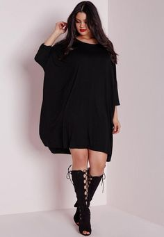 Work some seriously chic day cool vibes with this black t-shirt dress. In on point jersey fabric, this oversized beaut is the perfect throw-on-and go!