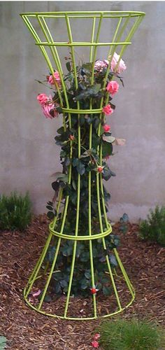 Terra Trellis's Lazlo piece.  Hmmmm, something similar could be made with 2 colored tomato supports.