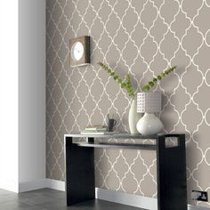 Wallpaper is back! We love classic prints like this allen + roth accent wall in Trellis Spanish Tile