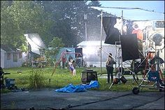 This image shows just some of the pre shoot manipulations that occur on the set of one of Gregory Crewdson's productions. Along with extensive lighting there is extreme attention paid to the the detail of not only the subject but the surroundings included. Everything in Crewdson's work is there for a reason, it adds more depth to an image and helps portray the moment he wants to capture.