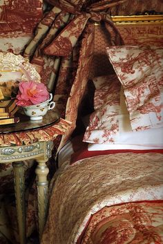 Toile was identified by its printed cotton, which was made in the eighteenth century the French village of Jouy -en- Josas, near Versailles. It was first available in floral and striped designs, followed by pictorial groups, which reflected the local news- stories told on fabrics. Different shades of red, blue, green and eggplant scenery were printed on a white or cream background.
