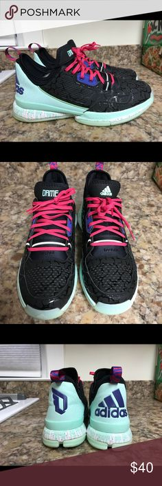 Adidas D Lillard glow in the dark shoes. Size 11. Don't know too much. Size 11. Released on holloween 2015. Has the date on the bottom of shoe. Was related to zombies. The graphic print on upper is supposed to be brains. Also the soles glow in the dark.  No box.  Used. But clean and well taken cared for. adidas Shoes Sneakers