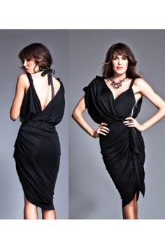 64ed6a569b96 Get sassy in a unique dress from Nicole Bakti. A flowing short sleeve is  paired with a shoulder strap and a halter neckline. The plunging neckline  borders a