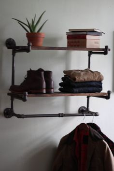 Industrial shelf with hanging bar (No assembly needed). via Etsy.