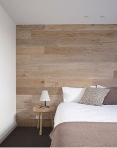 Timber wall paneling in guest room. Continuance of flooring. Streamline  Possibly use wallpaper for same effect