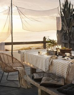 What a perfect decor and setting on the terrace at this summerhouse - airy, bright, welcoming and matching.