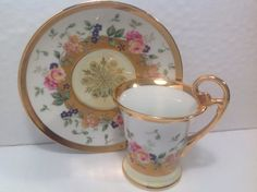 Gorgeous vintage KPM Porcelain Demitasse Cup Saucer. Heavy gold accents. With beautiful flowers around the cup and saucer.  Both pieces are in very good vintage condition.    The cup measure 3 7/8 tall including the high handle.The saucer is 5 1/2 approximately in diameter.    We will ship to locations outside of the United States. Please contact us before ordering for shipping costs.  Thank you for looking. Please check out other vintage items in our shop.