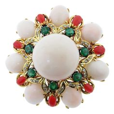 Vibrant Two Color Coral Emerald Diamond Gold Brooch | From a unique collection of vintage brooches at https://www.1stdibs.com/jewelry/brooches/brooches/
