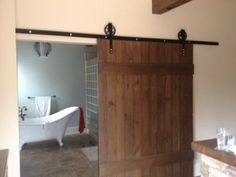 Another REBARN Bathroom Barn Door extra wide with our custom 6 inch spoke barn door hardware power coated black. Share it! Pin it! Half Bathroom Remodel, Bath Remodel, Double Wide Remodel, Bathroom Barn Door, Barn Door Hardware, Barn Doors, Simple Bathroom, Furniture For Small Spaces, Home Projects