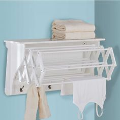 Accordion Drying Rack | When not needed, the Accordion Drying Rack is hidden under an attractive shelf that can hold photos, decorative items, or supplies. But when you want to air-dry delicates, wet gloves or damp towels, the rack pulls out easily to provide 11 sturdy hanging bars. The Accordion Drying Rack also includes 5 metal hooks for additional hanging space. Crafted of wood composites with a water-resistant white finish. Shop at SkyMall.com!