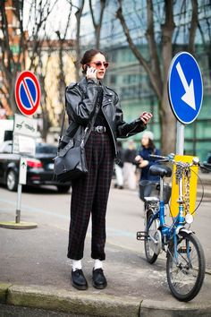High waisted plaid trousers and an edgy leather jacket. #MFW