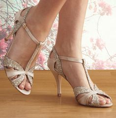 Scarlett is a delicate dance shoe with a peep toe & plaited t-bar. It's made from ivory satin, platinum glitter and gold suede. It has a comfortable 85mm heel.