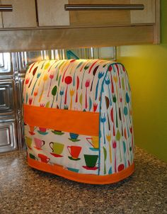 Free pattern for Kitchen Aid mixer cover here:  http://sewing.about.com/od/homedecprojects/ss/Free-Pattern-And-Directions-To-Sew-Your-Own-Stand-Mixer-Or-Blender-Cover.htm