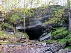 "Entrance to War Eagle Cavern, near Beaver Lake in Northwest Arkansas. This cave extends for four miles underground, and was reportedly used by numerous outlaws, including Jesse and Frank James as a ""hideout"" while on the run."
