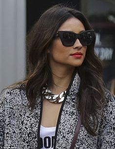 Made up: Shay hid her eyes behind a pair of cat eye sunglasses, but showed off a lovely bright red lipstick