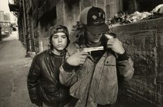 """Mary Ellen Mark (American, born 1940) """"Rat"""" and Mike with a Gun, Seattle 1983 Gelatin silver print 22.8 x 34.2 cm (9 x 13 7/16 in.) © Mary Ellen Mark The J. Paul Getty Museum, Los Angeles"""