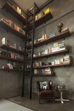 San Francisco loft with double-height library and ladder. Shelving is walnut.