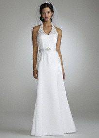 149 Elegant and timeless, you will be the picture of perfection in the stunning beaded lace gown! Halter bodice features ultra feminine beaded lace detail. Features set in satin sash at waist with embroidered rhinestone detail. (the sash is not removable) Available in White. Fully lined. Back zip. Imported polyester. Spot clean.A neckline featuring straps that wrap around from the front and connect at the back.A smooth fabric often used in bridal gown design because of its exquisite drape.