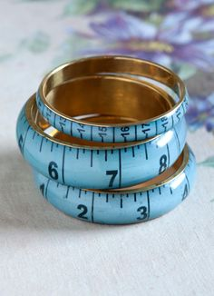 vintage dressmaker's tape-measure bangles are available in petrol blue, magenta, light petrol and mustard