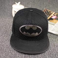 This cap is unusual as it has a metal Batman logo attached to the front. fb82871c0d4