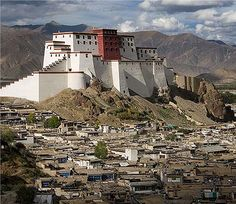 Samdrubtse Dzong or Shigatse Dzong, Shigatse, Tibet. Samdrubtse Dzong was probably built in the 15th century. It looked like a smaller version of the Potala. It had had turret-like fortifications at the ends and a central Red Palace. It used to be the seat of the kings of Ü-Tsang and the capital of the province of Ü-Tsang or Tsang.
